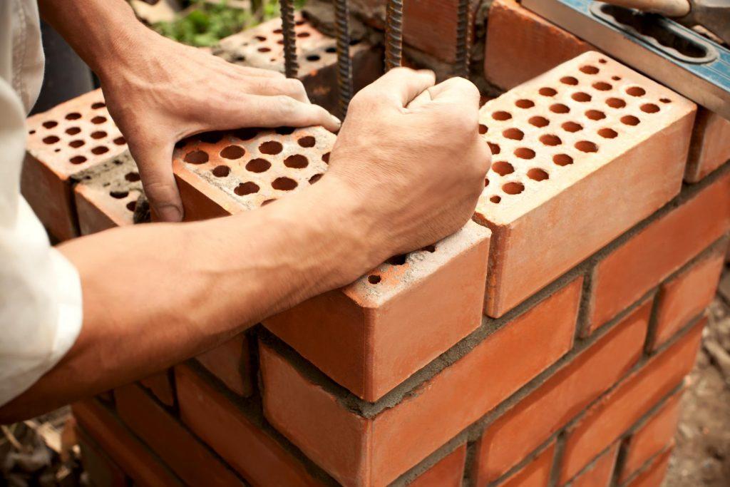 pressing in so hard to bricks so it will stick
