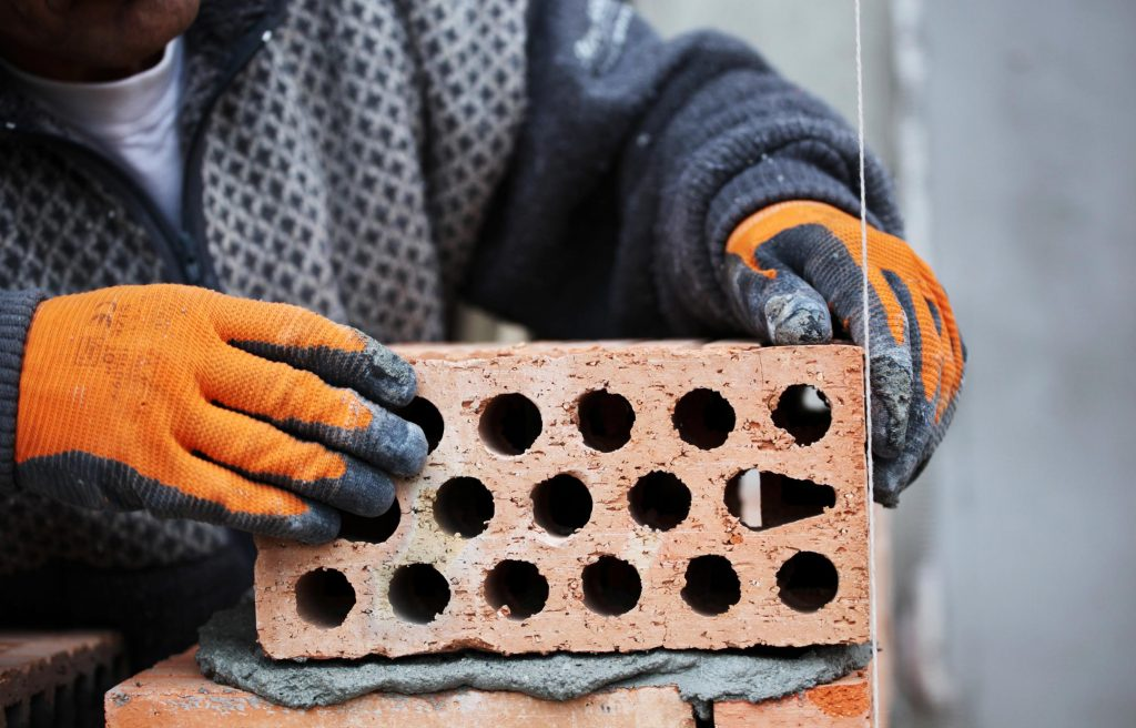 man putting concrete bricks